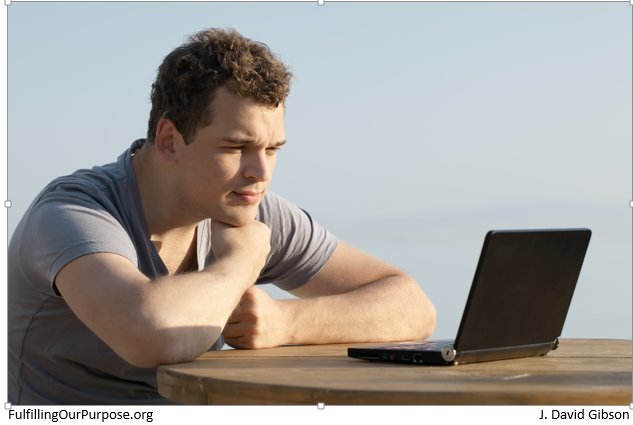 man-looking-at-computer-screen-tagged